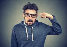 Verstoorde mens in misverstand het overreacting stock fotografie