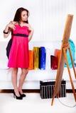 Versuchen auf neuem Kleid Lizenzfreie Stockbilder