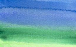 Vert au fond bleu d'aquarelle Image stock