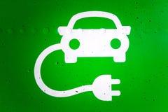 Vert et tandis que symbole de station de charge de voiture électrique Photo stock