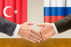 Vertegenwoordigers van Turkije en Rusland Royalty-vrije Stock Afbeeldingen