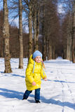 Funny little girl playing in winter Stock Photography