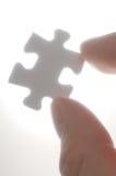 拾起一个难题的人员编结光。(vertica 免版税库存照片