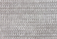 Verticaal Gray Knitting of de Gebreide Stof Backgro van het Textuurpatroon royalty-vrije stock foto's