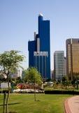 Vertical Abu Dhabi skyline. Vertical format of blue office building in Abu Dhabi in UAE stock images