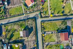 Vertical aerial view of an allotment garden with huts, garden and paths stock photography