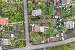 Vertical aerial view of an allotment garden with huts, paths and vegetable beds. royalty free stock photo