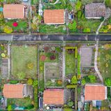 Vertical aerial view of an allotment garden with huts, paths and vegetable beds stock photography
