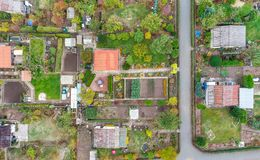 Vertical aerial view of an allotment garden with huts, paths and vegetable beds royalty free stock images