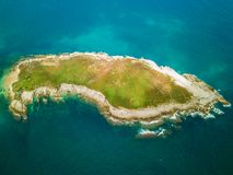 Vertical aerial view of green island. Cantabria, Spain Royalty Free Stock Image