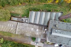 Vertical aerial view of an old abandoned factory plan. stock photography