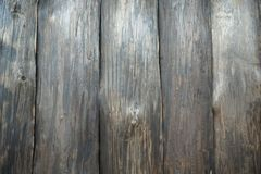 Vertical aged wall of dark wood, covered with varnish and stain. Lovely texture of the tree is clearly visible-knots and fibers. Vertical aged wall of dark wood stock image
