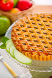 Vertical apple pie tart on wooden table with fruit background Royalty Free Stock Photo