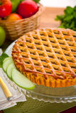 Vertical apple pie tart on wooden table with fruit background Stock Photos