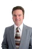 Vertical atractiva del hombre de negocios de 40 YO imagen de archivo
