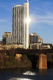 Vertical: Austin, Texas Skyline with Sun Flare. View of the Austin, Texas skyline with the river (called Town Lake), rail road bridge, and sun flare Stock Photography