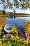 Vertical autumn landscape with aluminium boat Stock Image