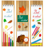 Vertical back to school banners with school tools and autumn leaves on wood surface. Stock Photo