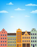 Vertical background with retro houses over blue sky with clouds Stock Photo
