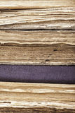 Vertical background stack of old books closeup Stock Images