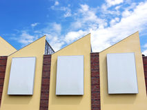 Vertical banners. Building wall with empty vertical places for advert Royalty Free Stock Photo