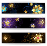 Vertical banners with abstract flowers. Three vertical banner decorated with gold and silver abstract flowers with blue, brown and light background Stock Photography