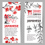 Vertical banners or flyers concepts set. Japanese red cherry flower branch blossom and bamboo silhouette Stock Image