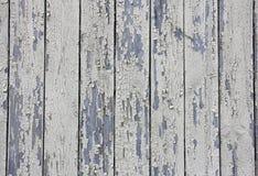 Vertical beige wooden planks with peeling paint, texture Stock Photos