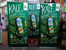 Vertical billboards. Outdoor advertising on Marigold Peel Fresh Kale and Veggie Juice drink products at a road show in Singapore Stock Photography