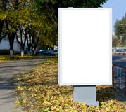 Vertical blank billboard. On the city street royalty free stock image