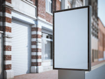 Vertical blank billboard on the city street with classic buildings. royalty free stock images