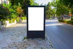Vertical blank billboard with copy space for your text message or content, outdoors advertising mock up. Public information board on city road. Empty Lightbox stock images