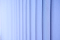 Vertical blinds. Abstraction. Photo of vertical blinds. Office room. Close-up Royalty Free Stock Photo