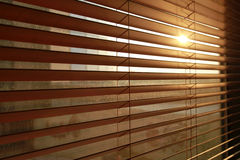 Vertical blinds background. Sunlight behind vertical blinds isolated Stock Images