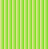 Vertical blinds. Vertical blinds in greenish-yellow tones.  Striped background. Green-and-yellow background. Household items Royalty Free Stock Photography