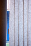 The vertical blinds on the window in the summer. Vertical sunblinds with an abstract pattern and a mechanism to close the window in the summer Royalty Free Stock Photo