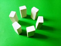 Vertical blocks in a circle isolated on a green background royalty free stock images