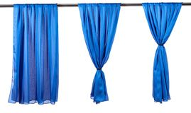Vertical blue satin curtains isolated on white. Background royalty free stock photo