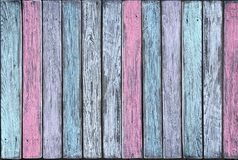 Vertical boards in different pastel shades. Colorful wooden wall made of vertical boards in different pastel shades stock images