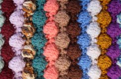 Vertical bobble crochet stitches, multi-coloured wool striped ba. Vertical bobble crochet stitches in multi-coloured wool stripes, as abstract background texture royalty free stock images