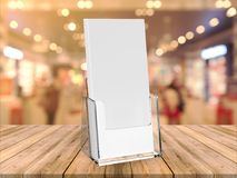 Vertical brochure holder display stand with blank white brochure on wooden base. Vertical brochure holder with blank white brochure on wooden base. 3d render Stock Image
