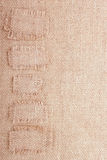 Vertical Burlap Background with Patches Royalty Free Stock Image