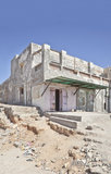 Dwarka property with open doors. Vertical capture of typical architecture, looking as of ruins with open doors, striking blue sky with rubble, litter and half Royalty Free Stock Photo
