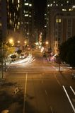 Vertical of car head lights in downtown san francisco at night Stock Photography