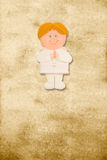 Vertical card first communion, funny blond boy Stock Photo