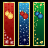 Vertical Christmas banners. Set of three vertical Christmas banners decorated with hanging balls,stars and snowflakes.Isolated on black background.EPS file Vector Illustration
