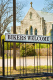 Vertical:Church sign with bicycle stand: Bikers Welcome. Church sign Fredericksburg, Texas welcoming bikers with a bike stand Stock Photo