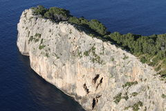 Vertical cliff on the sea Stock Images