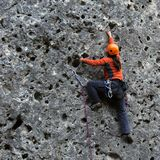 Vertical climbing. A person climbing a rock Stock Photos