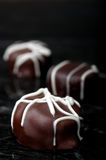 Vertical close up of chocolate truffles Stock Images